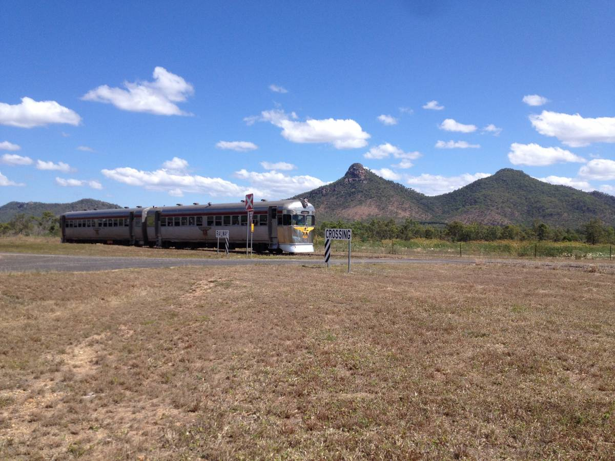 Savannahlander on Forsyth to Cairns line with Boonmoo Hill in background