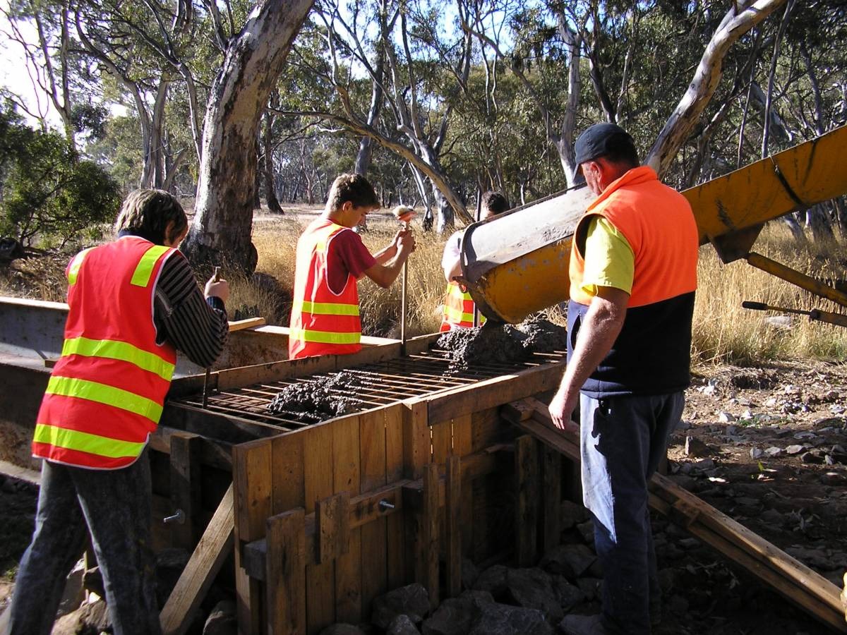 Students assisting with bridge construction (2005)