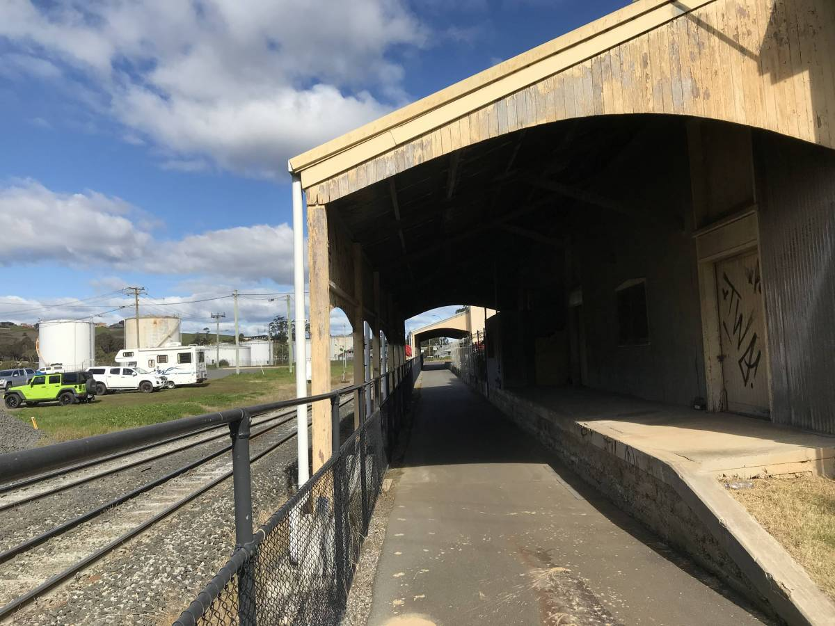 The trail passes right through the old rail goods sheds in Devenoport! This is unique in Australia. (2020)