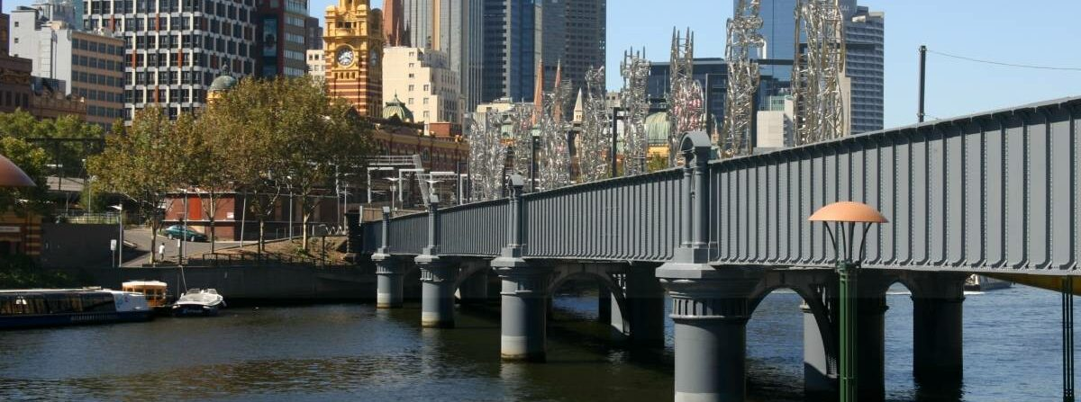 The former rail bridge over the Yarra River at Flinders St is a major feature (2007)