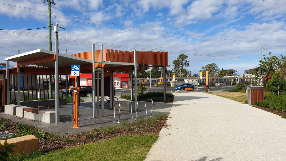 Bike repair station among the amenities at the start at Caboolture. Trains at the real station in the background (2019)